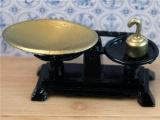 Weegschaal met gewicht zwart / brons